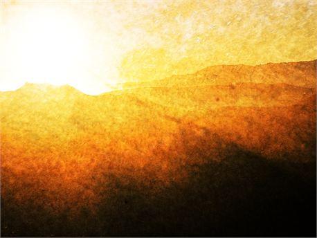 Sunrise_over_dark_mtns.jpg