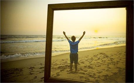 framed man worshiping on beach_1.jpg